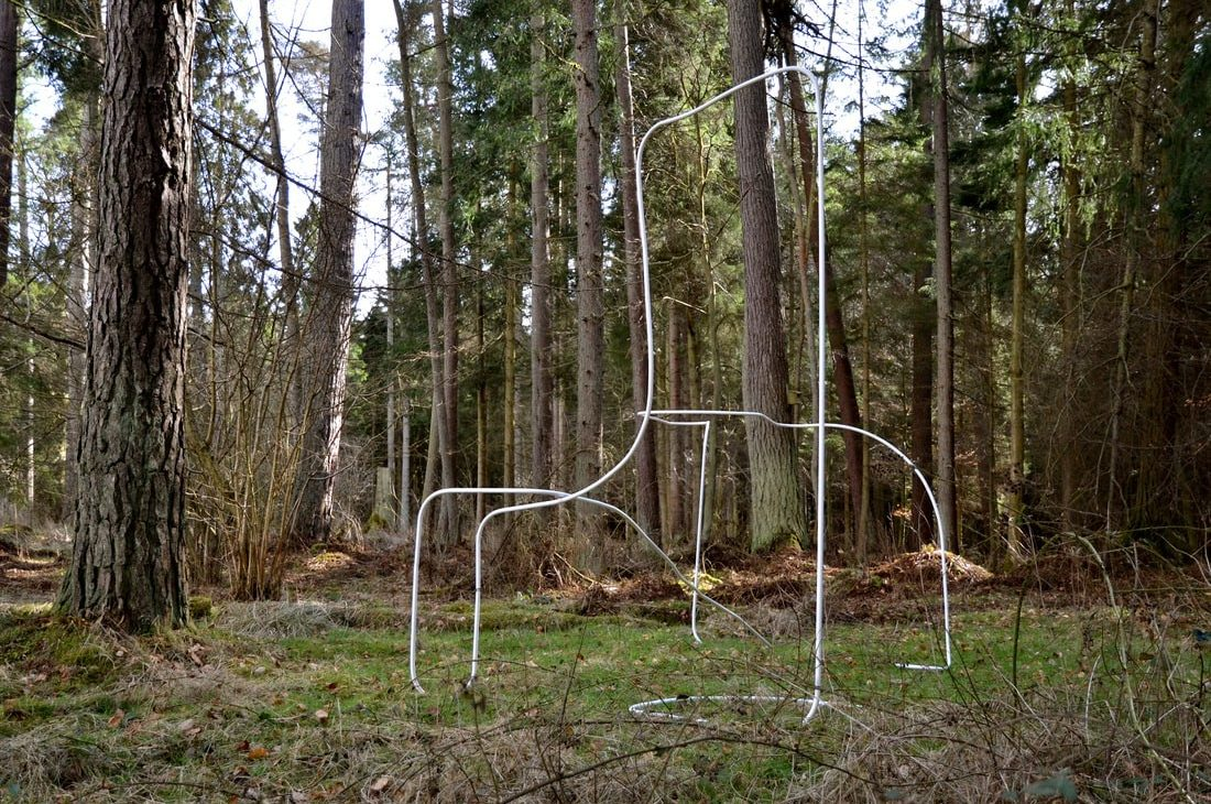 Bethan Radcliffe installation of past work in forest.