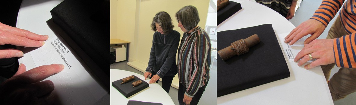 Three images: left - close up of fingers reading a label in braille, with printed text above; middle - two visitors stand at a table holding two sculptures, one visitor is reading the braille label; right - close up photo, showing an iron sculpture on a black cushion, and the hands of a visitor reading a braille label.